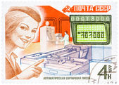 Stamp printed in USSR, shows mail processing (woman postal offic — Stock Photo