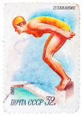 Stamp printed in USSR shows swimming, diving, female athlete jum — Stock Photo