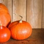 Pumpkins on grunge wooden backdrop background — Stock Photo #45784841