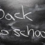Handwritten message on chalkboard writing message Back to school — ストック写真