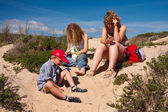 Family on the dunes — Stock Photo