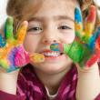 Preschool girl with painted hands — Stock Photo #17656111