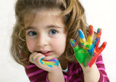 Preschool girl waving hello goodbye — Stock Photo
