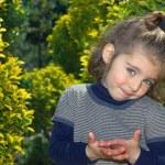 Little girl in the garden — Stock Photo