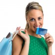 Happy smiling woman with shopping bags and credit card — Stock Photo