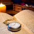 The antique book and old pocket-watch — Stock Photo