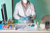 Doctor tagging sample for study — Stock Photo