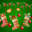 Hanging christmas socks with present and balls. - Stock Vector