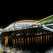 Bogdan Khmelnytsky Bridge (The Kiev foot bridge) through the Moskva River in Moscow at night. — Stock Photo