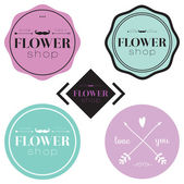 Collection of greeting floral labels — Stock Vector