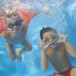 The children smile underwater — Stock Photo