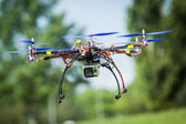 Flying a homemade helicopter with 6 rotors called hexacopter. — Stock Photo