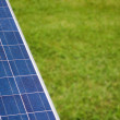 Solar panel with copyspace on green grass — Stock Photo