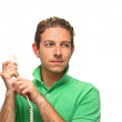 Attractive young man holding telephone — Stock Photo