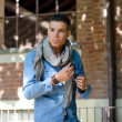 Stock Photo: Handsome guy with scarf and jeans garment