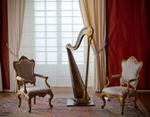Classic elegant chairs and harp — Stock Photo