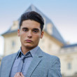 Good looking young male model and elegant palace — Stock Photo