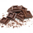 Stock Photo: Dark chocolate broken squares isolated on white