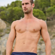 Swimmer or athlete, shirtless outdoors - Photo