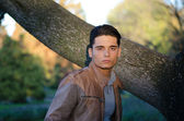 Attractive young male model in fall (autumn) outdoors in nature — Stock Photo