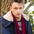 Portrait of handsome young man in winter clothes — Stock Photo