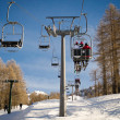 Aerial lift (chairlift) and skilift in sunny day — Stock Photo