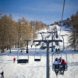 Chairlift (aerial lift) and skilift in sunny day — Stock Photo