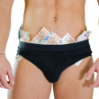 Close-up of male stripper underwear full of money banknotes — Stock Photo