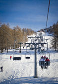 Chairlift (aerial lift) and skilift in sunny day — Photo