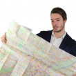 Stock Photo: Young mlooking at city map, confused or lost