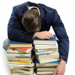 Young man falling asleep on books — Stock Photo #24747453