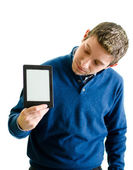 Young man looking at ebook reader — Stock Photo