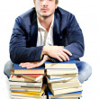 Student tired of studying on piles of books — Foto Stock