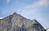 Cranes building on top of mountain — Stock Photo