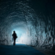 Human figure silhouette inside ice cave — Stock Photo