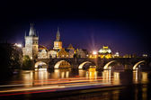 Night shot of Charles Bridge and river in Prague — Stock Photo