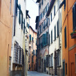 Narrow old urban street in italian town — Stock Photo