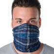 Young man masked as robber or bandit — Stock Photo