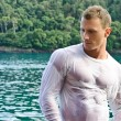 Handsome young bodybuilder by the sea with wet shirt on — Stock Photo #27778237