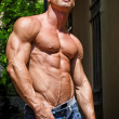 Attractive and muscular male bodybuilder shirtless — Stock Photo