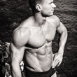 Stock Photo: Black and white photo of attractive muscular young mby sea