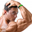 Closeup of young man with muscular arm in front of his face — Stock Photo