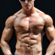 Stock Photo: Handsome, muscular shirtless muscle misolated on black