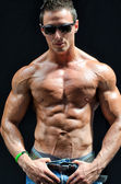 Handsome, muscular shirtless muscle man isolated on black — Stock Photo