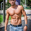 Bald young man shirtless outdoors — Stock Photo #29579651