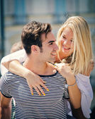 Romantic couple looking at each other smiling and having fun — Stock Photo