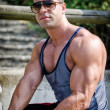 Attractive young bodybuilder outside — Stock Photo