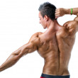 Handsome young muscle man showing muscular back — Stock Photo