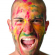 Handsome young man screaming with face's skin all painted with colors — Stock Photo