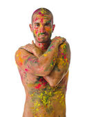 Handsome young man with skin all painted with colors — Stock Photo